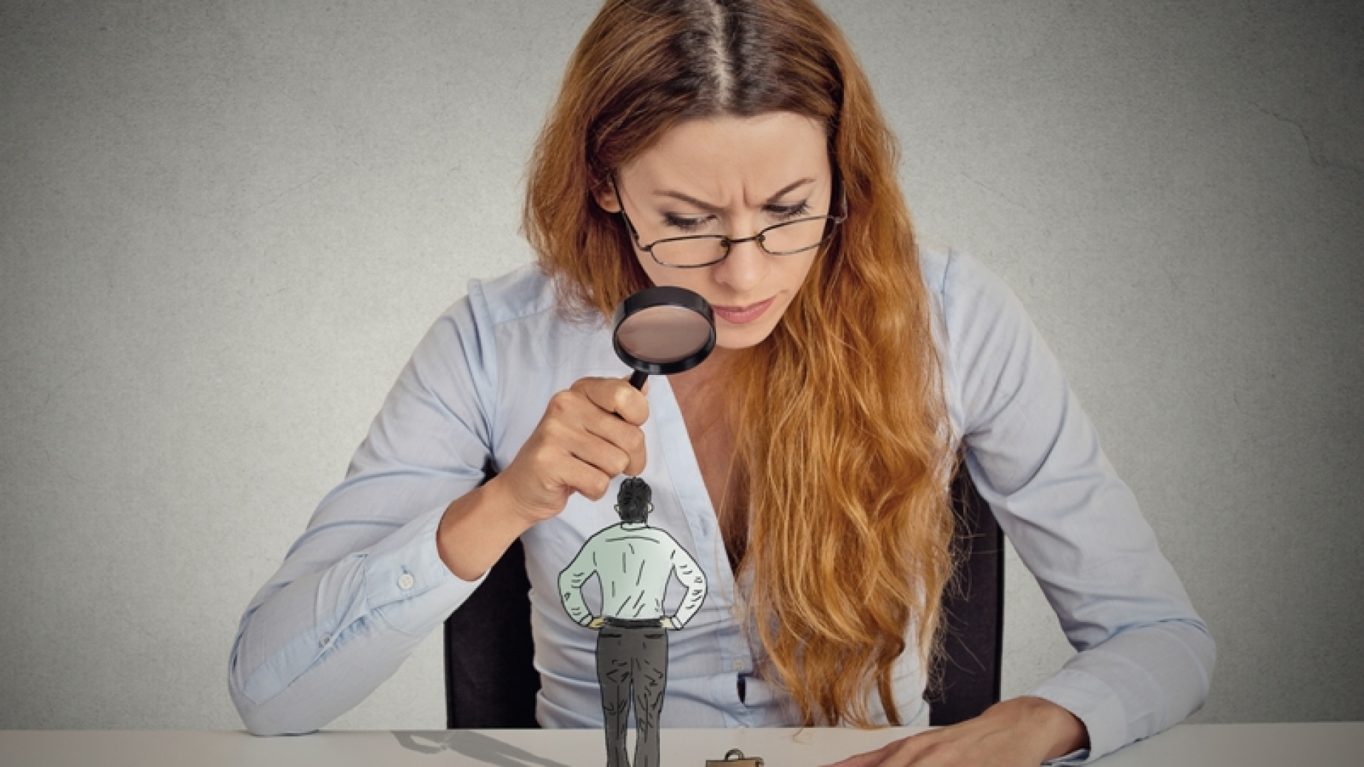 http://www.dreamstime.com/royalty-free-stock-photos-businesswoman-skeptically-looking-small-employee-magnifying-glass-curious-corporate-meeting-standing-table-isolated-image48999558